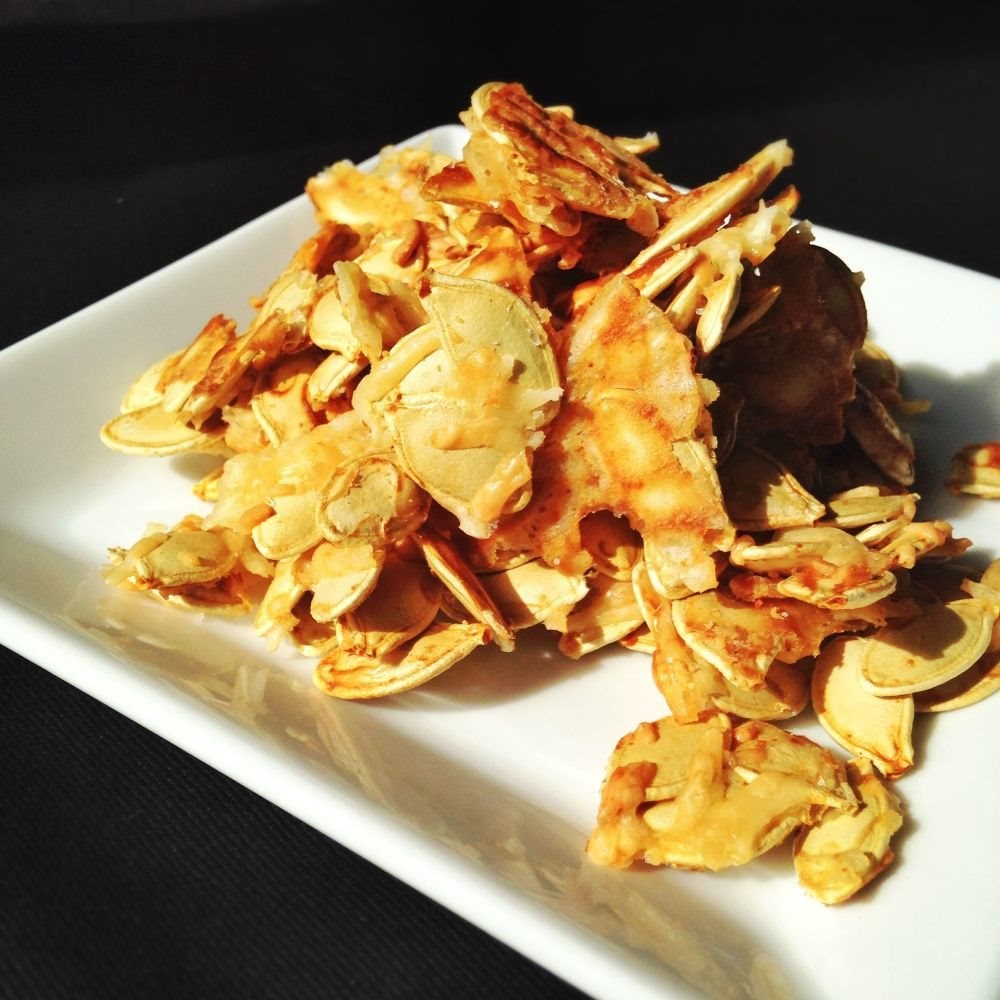 Spicy and Cheesy Toasted Pumpkin Seeds